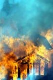 Ciérrese para arriba de casa ardiente imagen de archivo libre de regalías