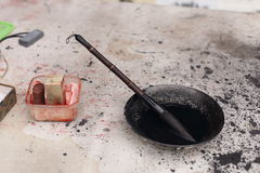 Ciérrese para arriba de cepillo de escritura del chino tradicional en la tinta negra Imágenes de archivo libres de regalías