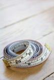 Ciérrese para arriba de cinta métrica Imagenes de archivo