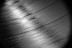 Ciérrese para arriba de disco de vinilo en B&W Imagenes de archivo