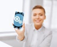 Ciérrese para arriba de empresaria con smartphone Fotografía de archivo libre de regalías