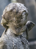 Ciérrese para arriba de escultura de la querube Imágenes de archivo libres de regalías