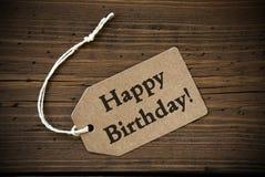 Ciérrese para arriba de etiqueta con feliz cumpleaños del texto Fotografía de archivo