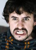 Ciérrese para arriba de hombre joven enojado Imagenes de archivo