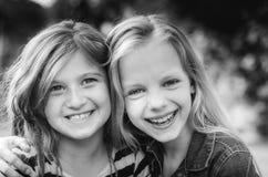 Ciérrese para arriba de la cara de niños felices mientras que ríe Imágenes de archivo libres de regalías