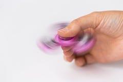 Ciérrese para arriba de la mano que juega con el hilandero de la persona agitada Foto de archivo libre de regalías