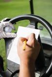 Ciérrese para arriba de la mano que llena un trozo de papel Imagen de archivo libre de regalías