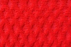 Ciérrese para arriba de la materia textil roja de las lanas del modelo Imagenes de archivo
