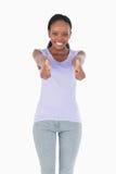 Ciérrese para arriba de la mujer que da los pulgares para arriba Imagen de archivo libre de regalías