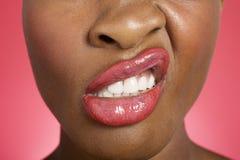 Ciérrese para arriba de la mujer que hace una cara Fotografía de archivo libre de regalías