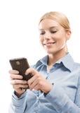 Usando el teléfono elegante Imagen de archivo libre de regalías