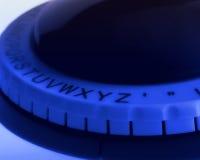Ciérrese para arriba de la rueda del alfabeto del fabricante de la etiqueta Imagen de archivo