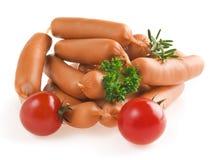 Ciérrese para arriba de la salchicha con los tomates y el romero Imagen de archivo libre de regalías