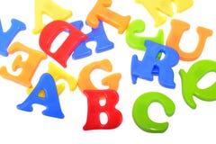 Ciérrese para arriba de las letras plásticas aisladas en blanco Fotografía de archivo libre de regalías
