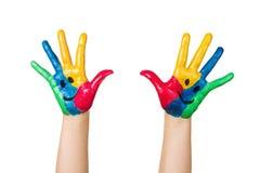 Ciérrese para arriba de las manos coloridas del niño Fotografía de archivo