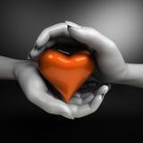 Ciérrese para arriba de las manos de la mujer que llevan a cabo el corazón Fotografía de archivo
