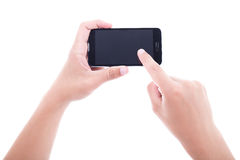 Ciérrese para arriba de las manos masculinas usando el teléfono elegante con isola de la pantalla en blanco fotos de archivo