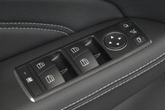 Ciérrese para arriba de los botones de coche de un panel de control de puerta Imagen de archivo