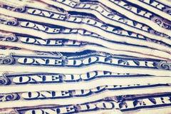 Ciérrese para arriba de los viejos uno billetes de dólar, profundidad del campo baja Imagen de archivo libre de regalías