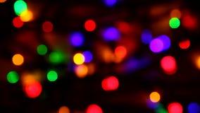 Ciérrese para arriba de luces de la Navidad borrosas metrajes