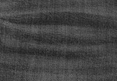 Ciérrese para arriba de modelo del fondo del dril de algodón negro Jean Texture Imagenes de archivo