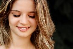 Ciérrese para arriba de muchacha con la mirada abajo Fotografía de archivo libre de regalías