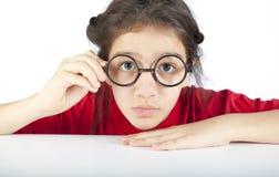 Ciérrese para arriba de muchacha nerdy bastante joven Fotos de archivo libres de regalías