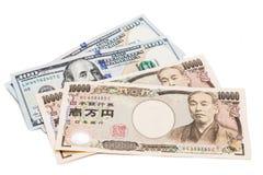 Ciérrese para arriba de nota de la moneda de los yenes japoneses contra dólar de EE. UU. Imágenes de archivo libres de regalías