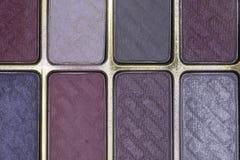 Ciérrese para arriba de polvo colorido de la sombra de ojos Imágenes de archivo libres de regalías