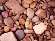 Ciérrese para arriba de rocas en la tierra Imágenes de archivo libres de regalías