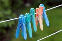 Ciérrese para arriba de seis clavijas de ropa Imagen de archivo libre de regalías