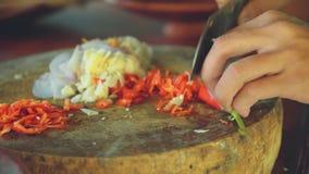 Ciérrese para arriba de tajar de la pimienta roja