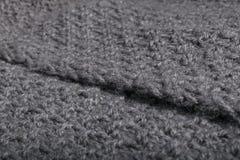 Ciérrese para arriba de tela gris hecha punto de las lanas Fotos de archivo
