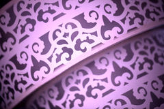 Ciérrese para arriba de tela púrpura con diseño Foto de archivo libre de regalías