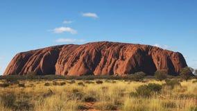 Ciérrese para arriba de uluru en el Territorio del Norte de Australia en la puesta del sol