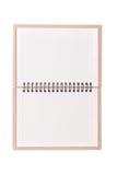 Ciérrese para arriba de un cuaderno en blanco Imagen de archivo libre de regalías