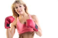 Ciérrese para arriba de un fondo femenino del blanco del boxeador Foto de archivo libre de regalías