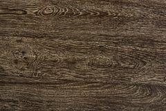 Ciérrese para arriba de un fondo texturizado entarimado de madera marrón foto de archivo libre de regalías