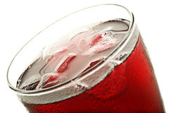Ciérrese para arriba de un vidrio de zumo de fruta rojo Fotografía de archivo