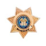 Ciérrese para arriba de una estrella de oro del sheriff de los E.E.U.U. Fotografía de archivo libre de regalías