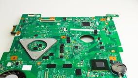 Ciérrese para arriba de una placa de circuito verde impresa del ordenador fotografía de archivo