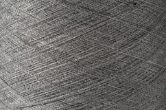 Ciérrese para arriba de una textura gris del hilado Foto de archivo