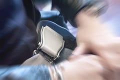 Ciérrese para arriba del cinturón de seguridad sujetado del aeroplano con efecto dramático del enfoque Imagen de archivo libre de regalías