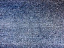 Ciérrese para arriba del dril de algodón azul de la mezclilla inconsútil para la textura y el fondo Imagen de archivo