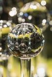 Ciérrese para arriba del globo de cristal que refleja otros globos imagen de archivo libre de regalías