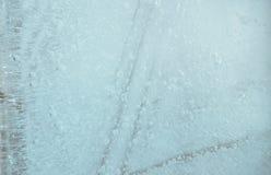 Ciérrese para arriba del hielo en fondo plástico y texturice Imágenes de archivo libres de regalías