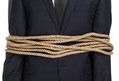 Ciérrese para arriba del hombre de negocios atado con la cuerda Fotos de archivo libres de regalías