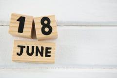 Ciérrese para arriba del texto del 18 de junio en bloques de madera Fotos de archivo libres de regalías