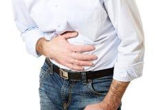 Ciérrese para arriba en el hombre maduro que sufre del dolor de estómago Fotos de archivo libres de regalías