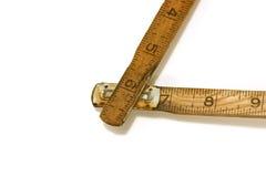 Ciérrese para arriba en una vieja esquina de medición de la cinta/de la regla Imágenes de archivo libres de regalías